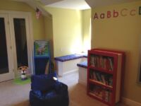 Reading corner in kids playroom